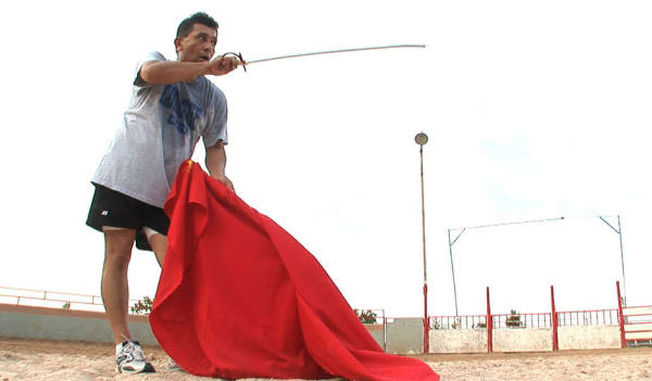 Longinos Mendoza practices his matador techniques in preparation for a bloodless bullfight. Photo: Meg Loucks, Chronicle