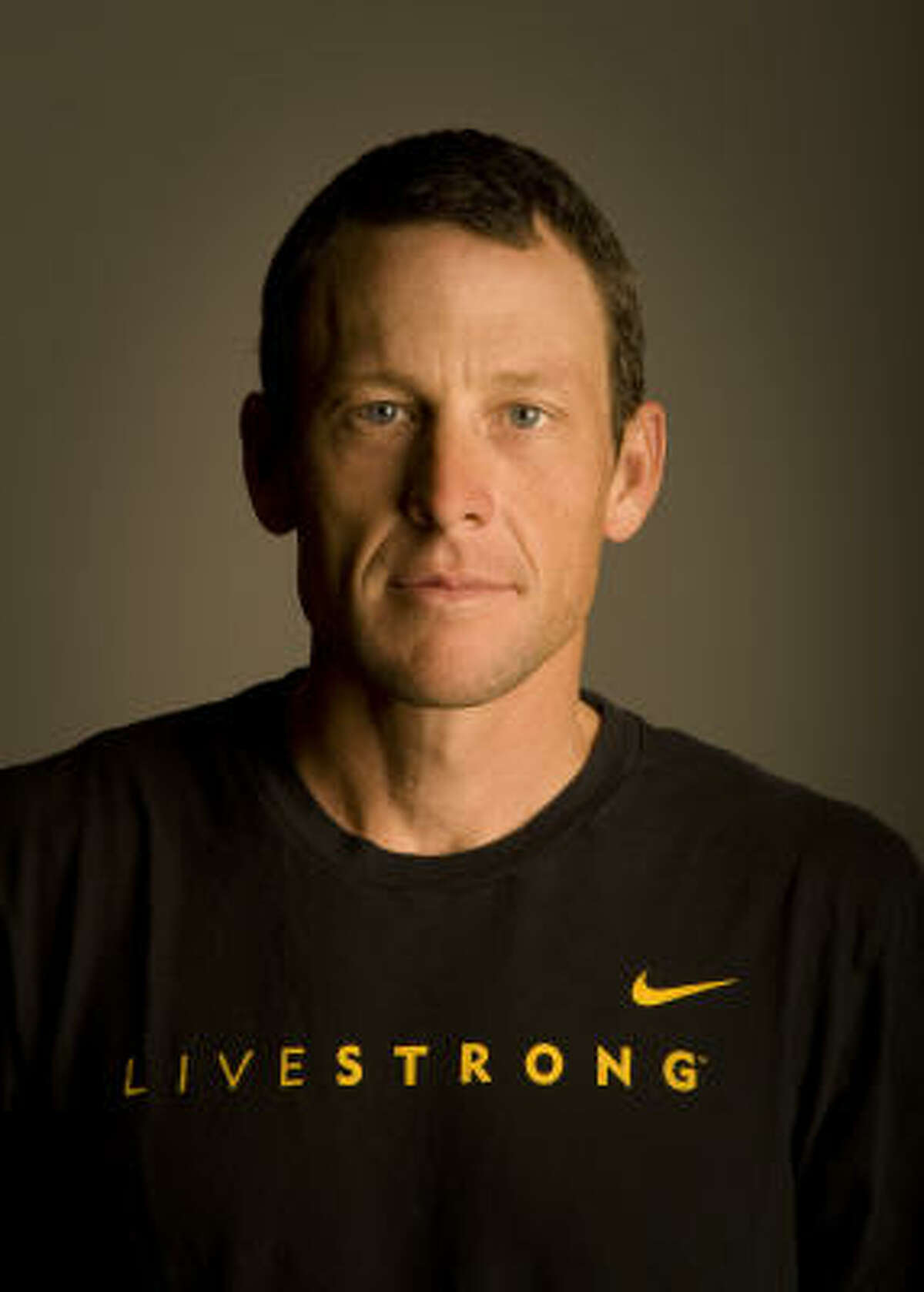 Lance Armstrong poses in the basement of his bike shop, Mellow Johnny's in Austin.
