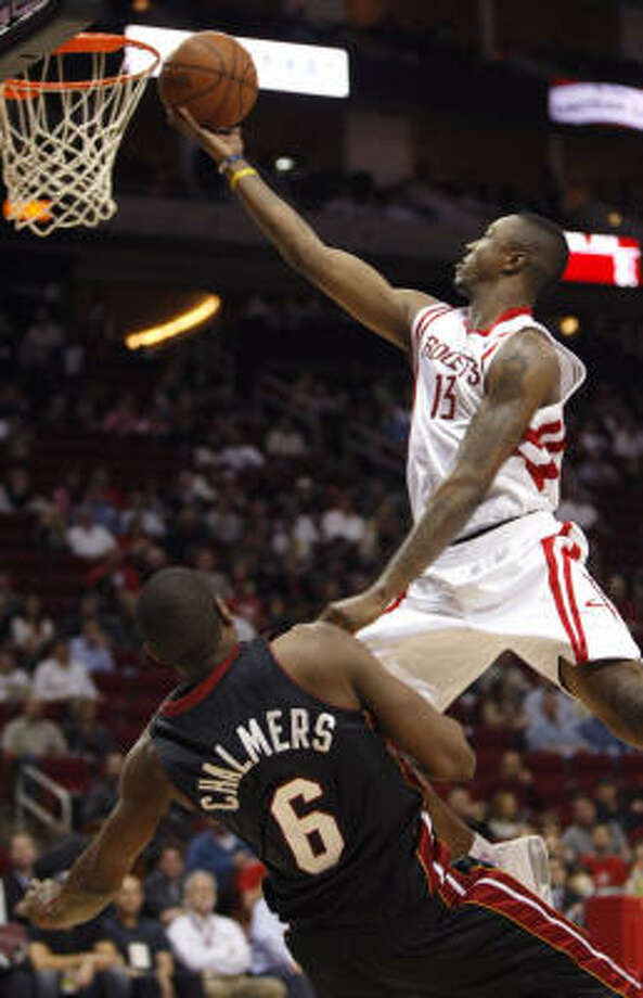 Von Wafer soars to the basket against Miami's Mario Chalmers in the first quarter. Photo: Brett Coomer, Chronicle