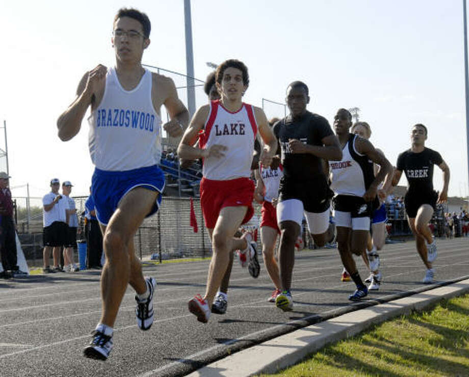 Brazoswood's Weston Caceres, left to right, Clear Lake's Sammy Abuhamra and Clear Creek's Mitchell Karlton finished first, second and third in the 800 meters at the District 24-5A meet. Photo: KIM CHRISTENSEN, FOR THE CHRONICLE