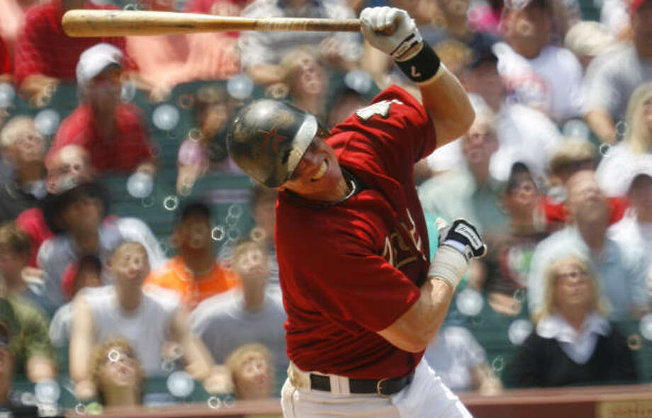 Craig Biggio wasn't pleased after leading off the game with an infield pop up. Photo: Steve Ueckert, Chronicle