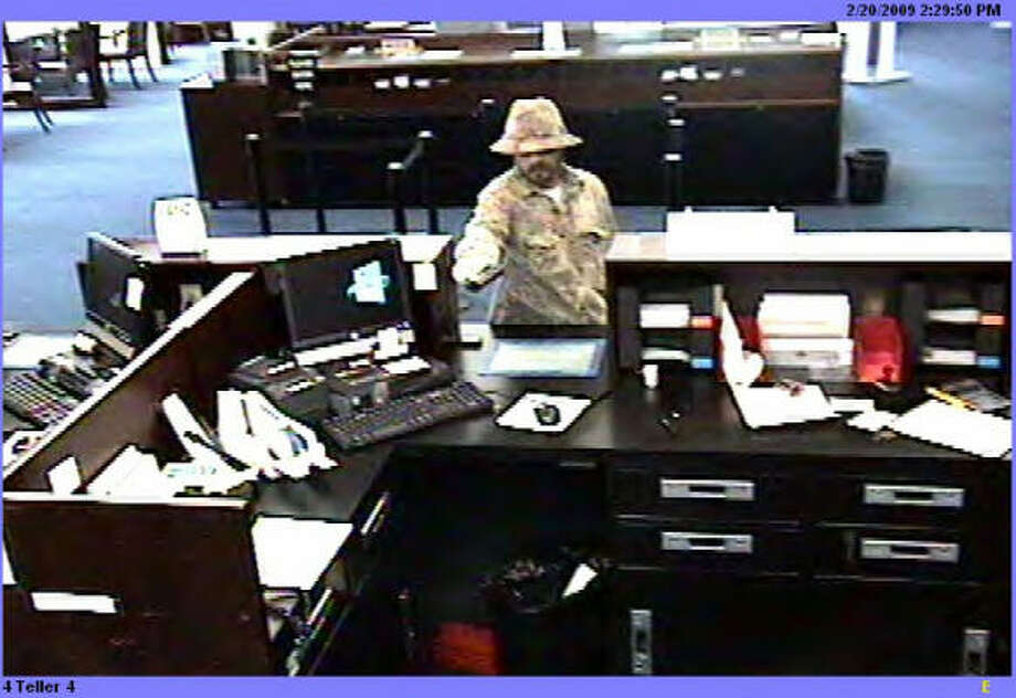 Friday, February 20, 2009 	Chase Bank 	8201 Kuykendahl Road  3:00 PM a white male, described to be in his late 20's to early 30's entered the bank wearing camo clothing and boots, sunglasses, and hat.  The suspect displayed a firearm (pistol) and demanded money from the teller.  The suspect left on foot to a nearby wooded area north of the bank.  No vehicle was seen.