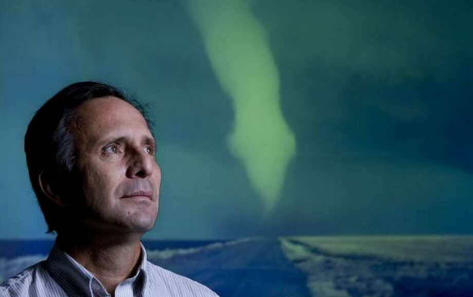 Storm chaser Tim Samaras, in front of a tornado image, says The Wizard of Oz shaped the course of his career. Photo: ERIC KAYNE, CHRONICLE