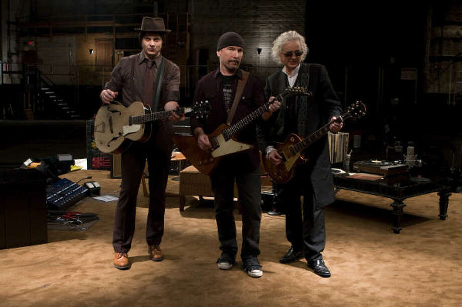Jack White, from left, The Edge, and Jimmy Page trade licks and ideas in the documentary It Might Get Loud. Photo: Eric Lee : Sony Pictures Classic
