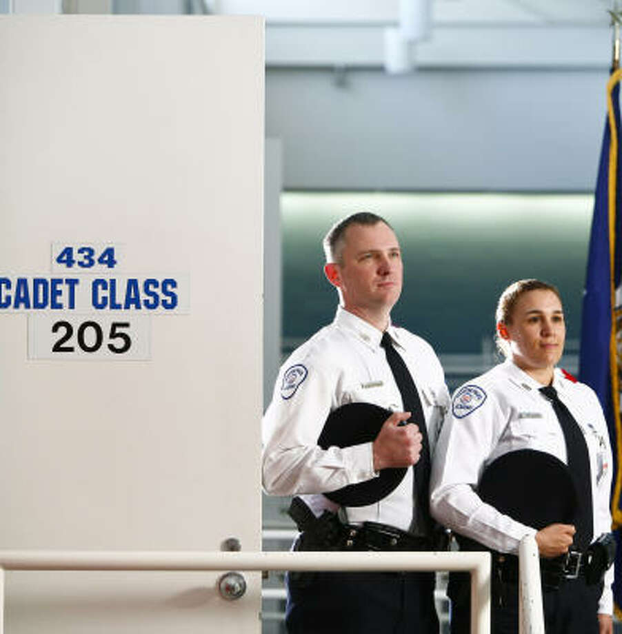 Mark Durham, a senior in the Houston Police Academy, and Michelle Elrod, a junior, are just two of an increasing number of people seeking jobs in law enforcement. Photo: Michael Paulsen, Chronicle