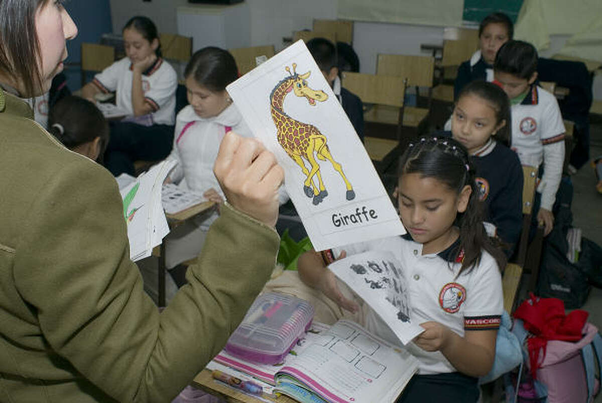 Sixth-grade students at the José Vasconcelos Elementary School in Ciudad Victoria, Tamaulipas, play a game using animal figures to help them develop English skills. The goal is to make Tamaulipas the first bilingual state in Mexico.