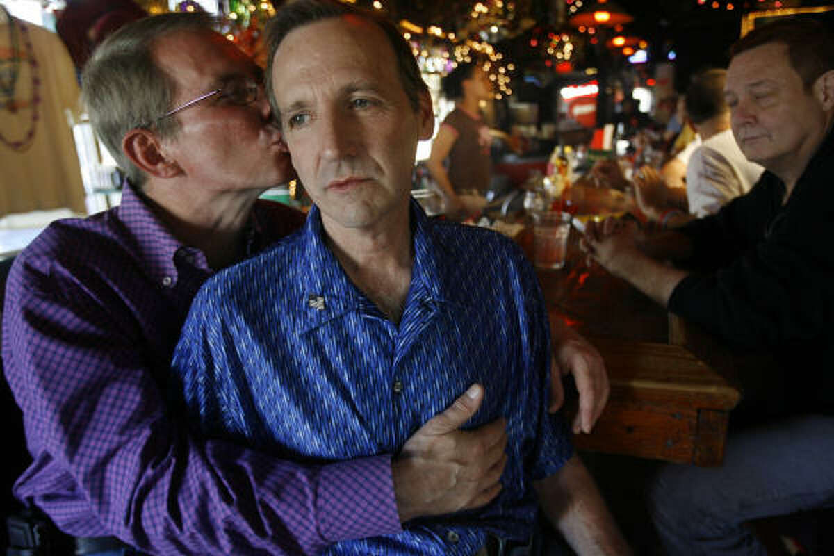 Victor Clements embraces partner Marc Bosaw, who was attacked on Saturday on Rosenberg Avenue in Galveston.