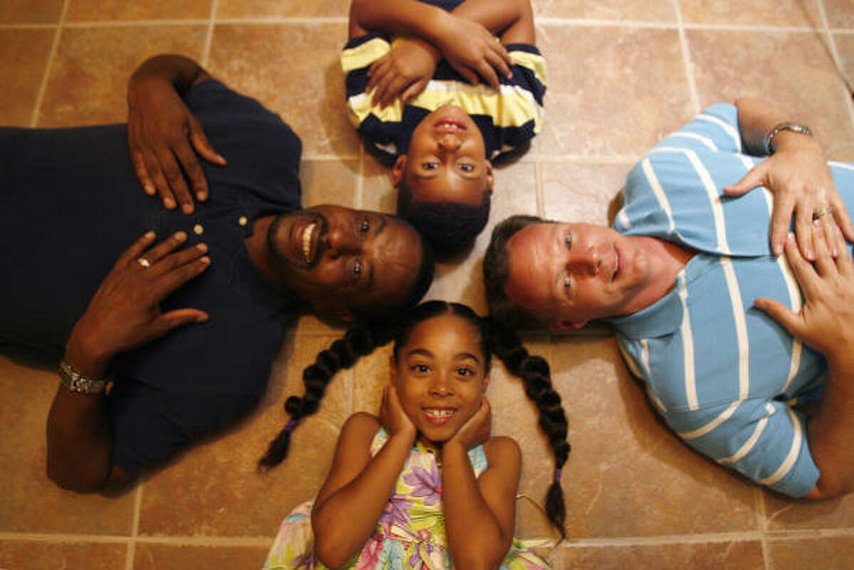 Bill Thomasson, left, and Ben Austin, right, are domestic partners and fathers who adopted Ava, 7, and Elijah, 6.