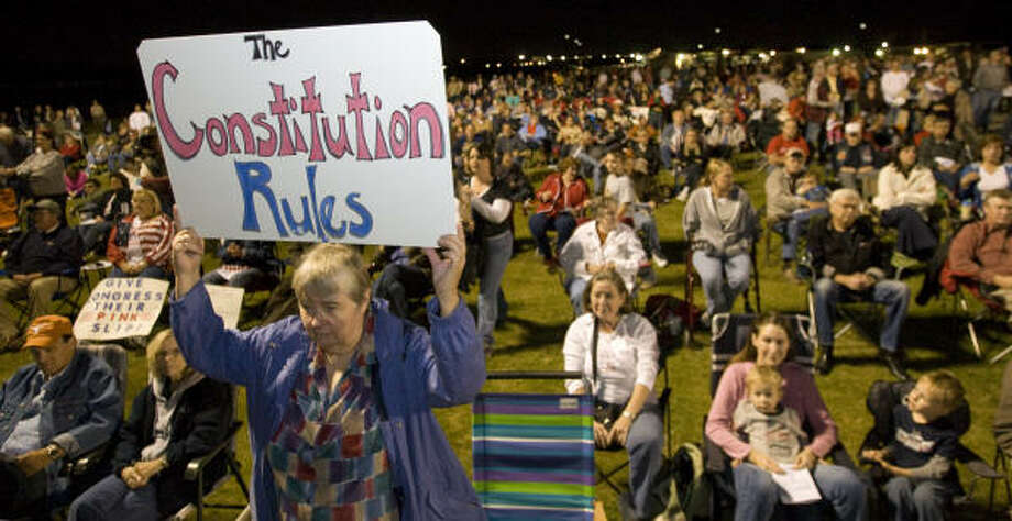 Gerry Hamilton makes her feelings known during the North Houston Tea Party rally at Sam Houston Race Park on Monday night. Photo: Brett Coomer, Chronicle