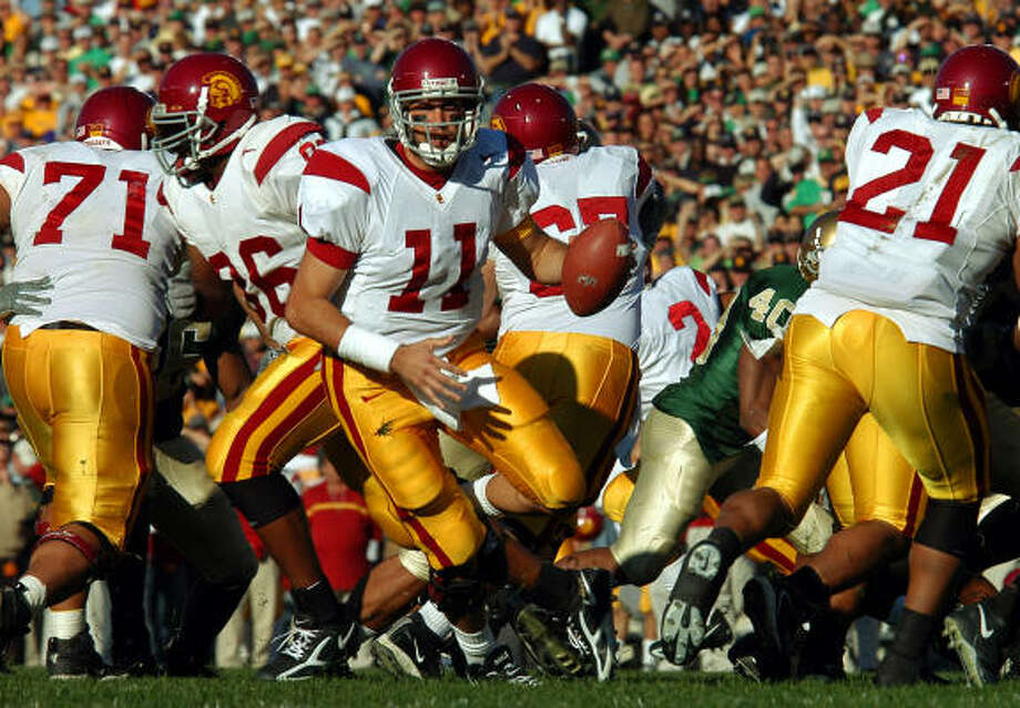 With three Heisman Trophy winners, a 34-game winning streak and victories over 37 ranked opponents, USC has an impressive list of credentials when it comes to making its case as the top college football program of the decade. Photo: JOE RAYMOND, AP