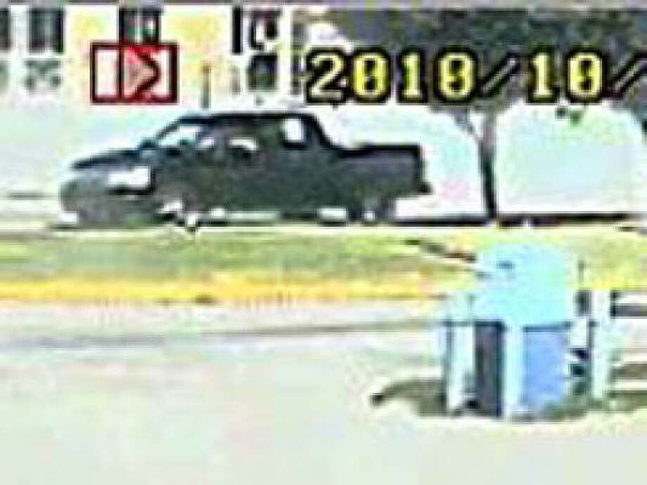 """Officers say this black truck was involved in a fatal """"road rage"""" shooting that killed Ted Mitsakos, 49, in southwest Houston last month. Photo: Houston Police"""