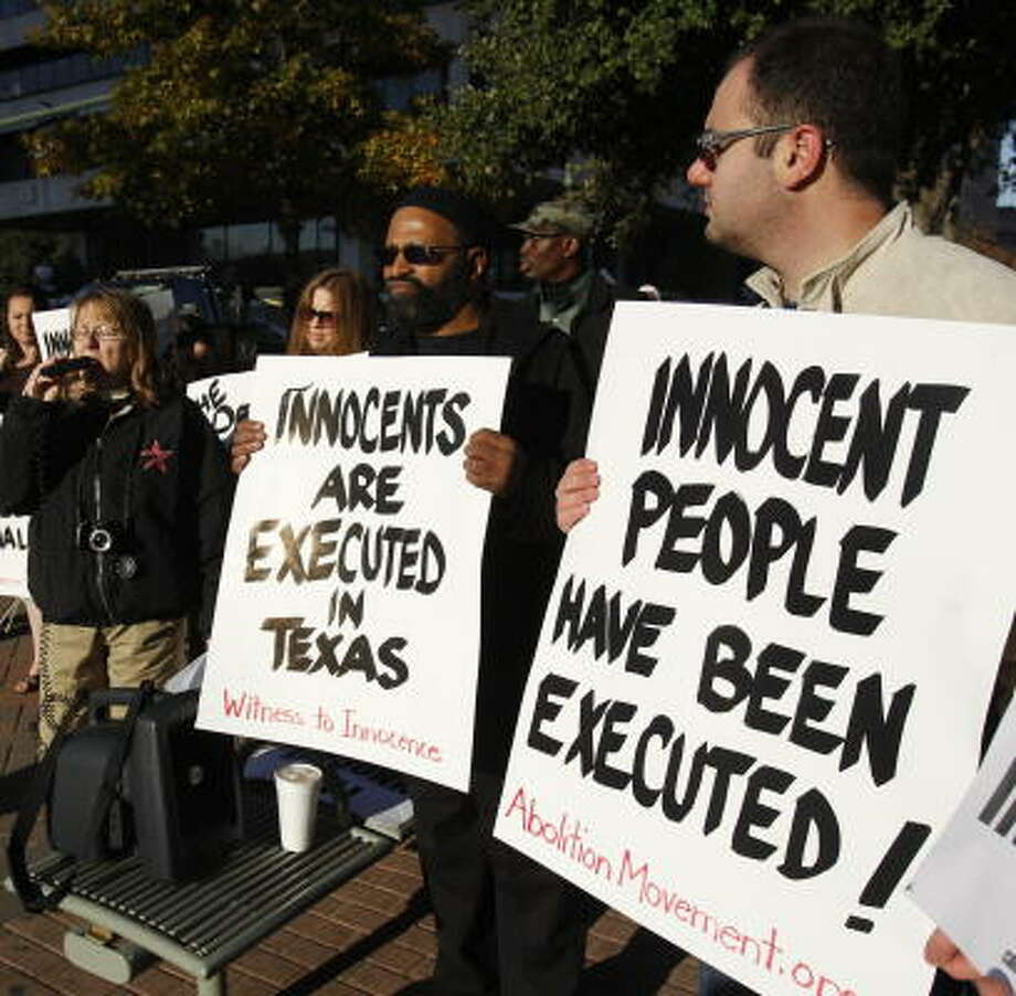 Protesters gather outside the Harris County Criminal Courthouse before a rare judicial review of the Texas death penalty. Photo: Melissa Phillip