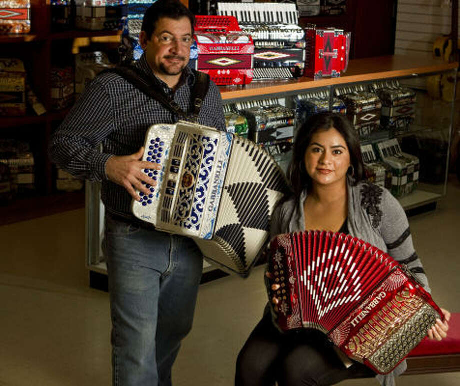 Mike Gabbanelli and his wife, Elia, serve as president and vice president, respectively, of the accordion business his father started in 1961 after immigrating from Italy. Photo: James Nielsen :, Chronicle