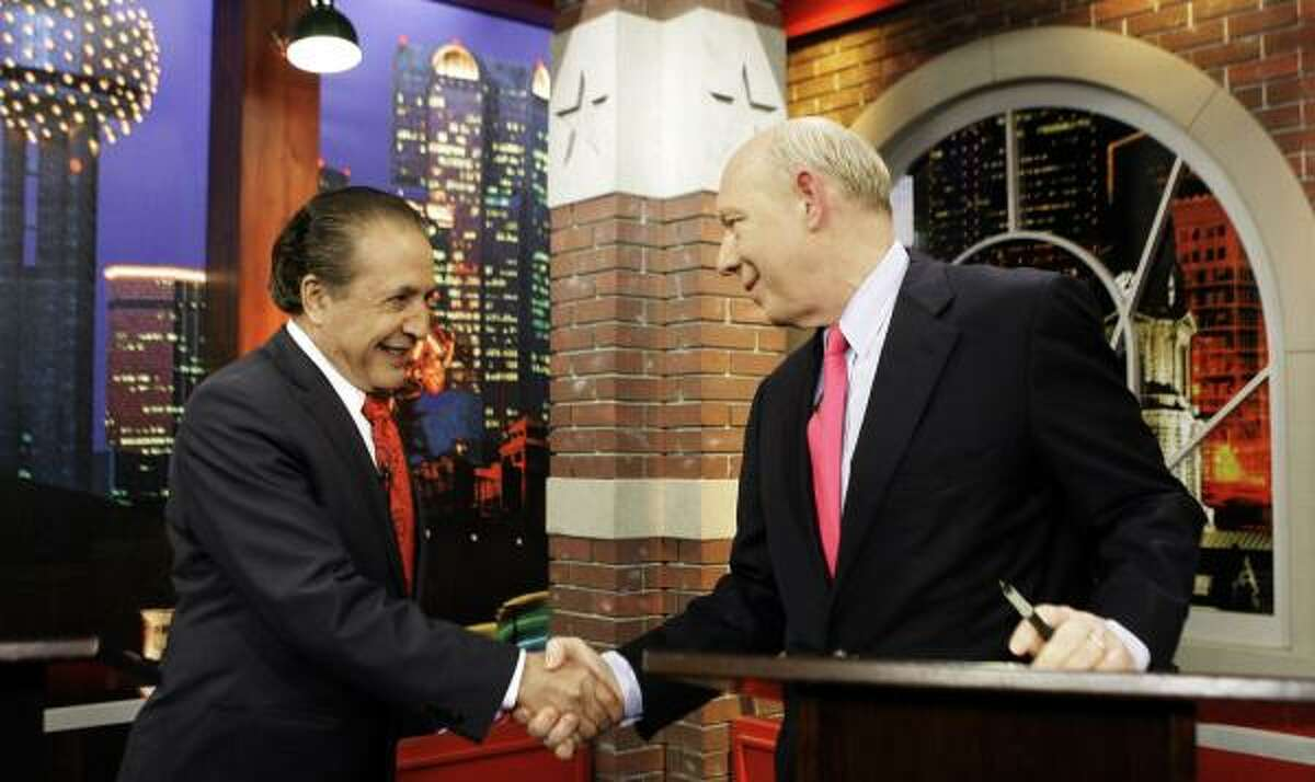 Democratic gubernatorial candidates Farouk Shami, left, and former Houston Mayor Bill White shake hands Monday in a Fort Worth television studio before their first debate.
