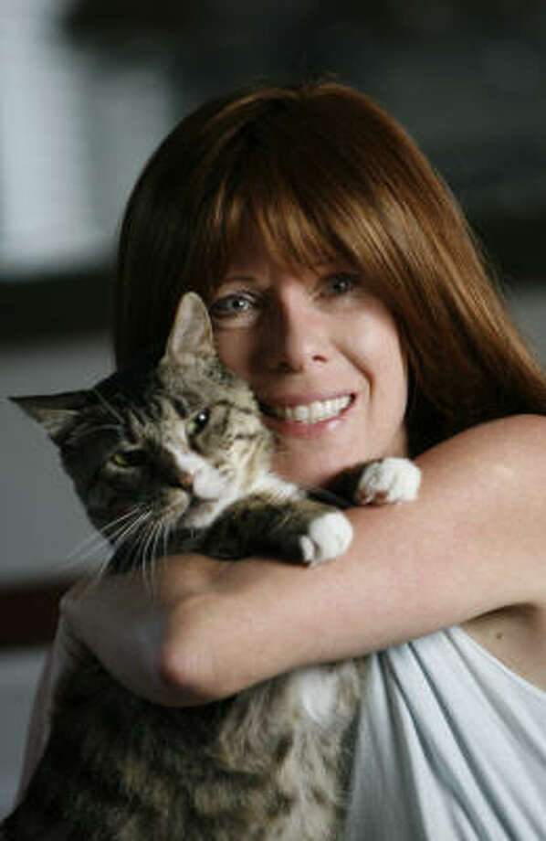 Brenda Young holds her cat Ted. On Tuesday, she found the mutilated body of one of the feral cats that she had been feeding. Photo: Karen Warren, Chronicle