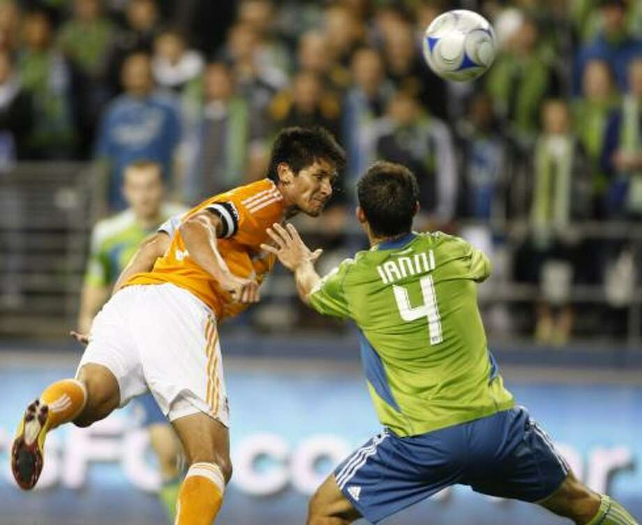 Brian Ching, left, said that the Dynamo are the team against which other MLS teams measure themselves. Photo: Kevin P. Casey, AP