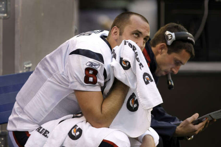 Texans quarterback Matt Schaub sits on the bench after throwing an interception late in the fourth quarter. Photo: Brett Coomer, Chronicle