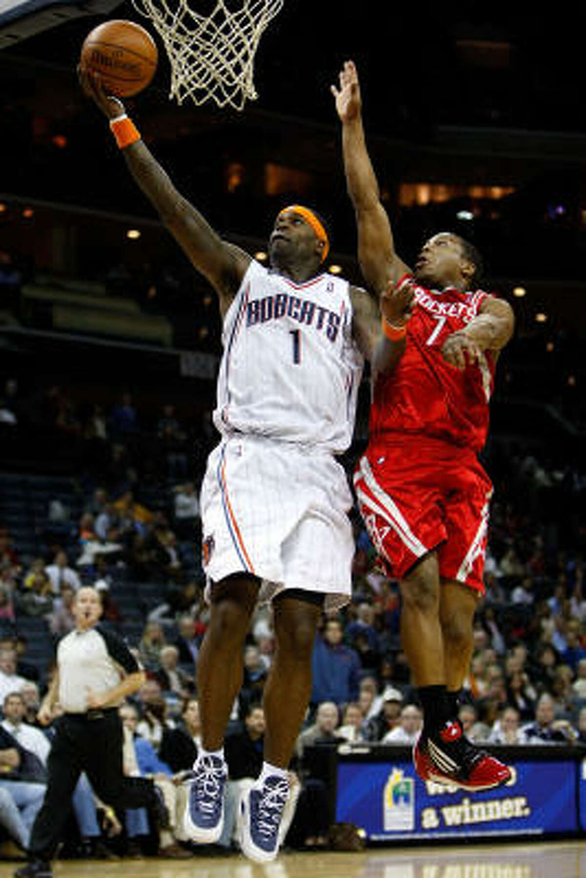 Rockets guard Kyle Lowry tries to block the Bobcats' Stephen Jackson in the first half.