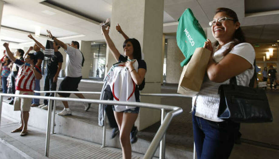Juanita Tierrafria, 19, center, and her mother, Raquel Padilla, right, were among the many on hand to greet the Mexican national soccer team on Wednesday. Photo: Julio Cortez, Chronicle