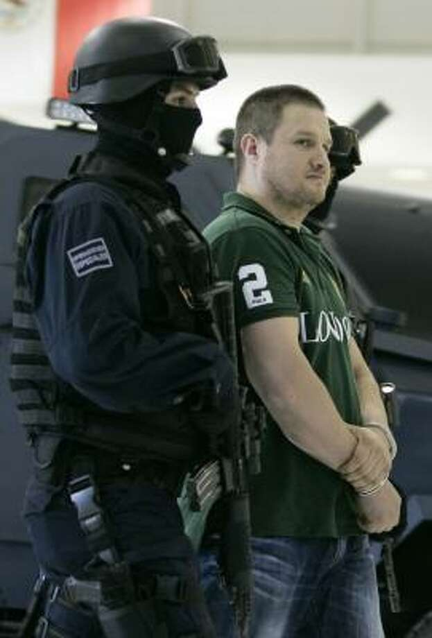 "Edgar ""La Barbie"" Valdez Villarreal is shown to the media during a news conference at the federal police center in Mexico City in 2010. Photo: Daniel Aguilar, Getty Images"