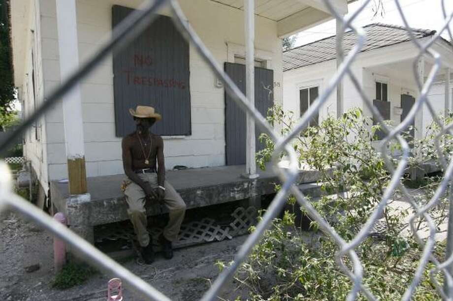 Fourth Ward resident Willie Wright, 60, sits in front of a boarded-up house. Wright and others have refused to move. Photo: MAYRA BELTRÁN, CHRONICLE