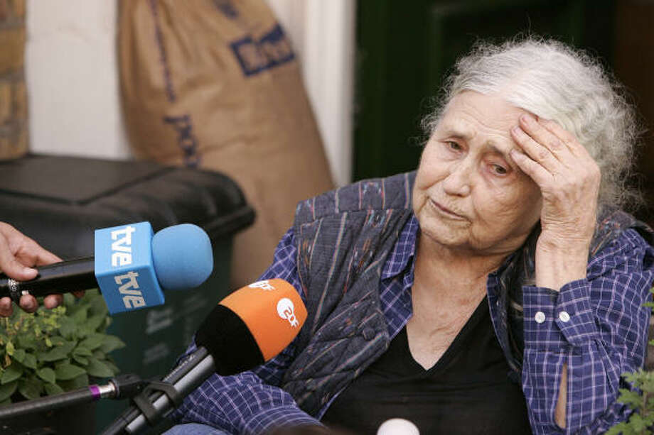 British writer Doris Lessing reacts as she is told by photographers that she has won the Nobel Literature Prize. Photo: SHAUN CURRY, AFP/Getty Images