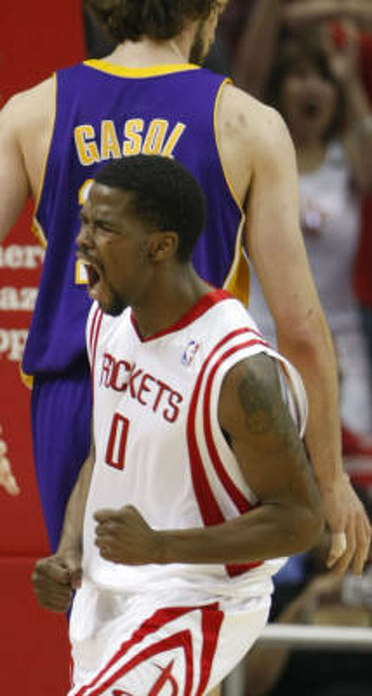 Aaron Brooks scored 34 points and had the look of a guy on his way to being special Sunday against Pau Gasol, back, and the Lakers.