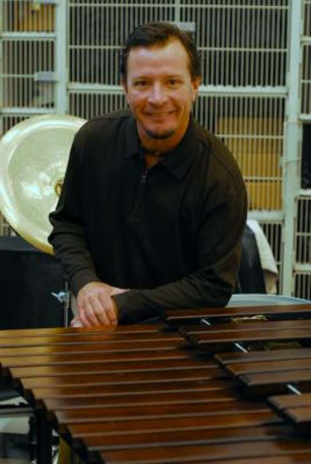 Tony Bullard: For the Chronicle PASSION FOR PERCUSSION: Lamar Burkhalter is the band director for the Houston Texans? Bullpen Pep Band and founder of the Percussion One Foundation. Photo: Tony Bullard, ALL