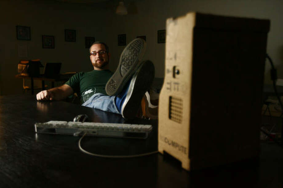 Houstonian Brenden Macaluso has designed a cardboard PC. It's not for sale or being mass produced, yet.  Photo: Mayra Beltran, Chronicle