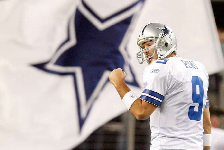 Tony Romo has thrown 26 touchdown passes and nine interceptions, setting a team record with 4,483 yards. Photo: Ronald Martinez, Getty Images