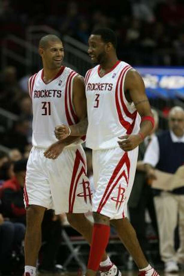 Rockets forwards Shane Battier and Tracy McGrady smile as they walk to bench after McGrady got his first points of the night. Photo: Billy Smith II, Chronicle