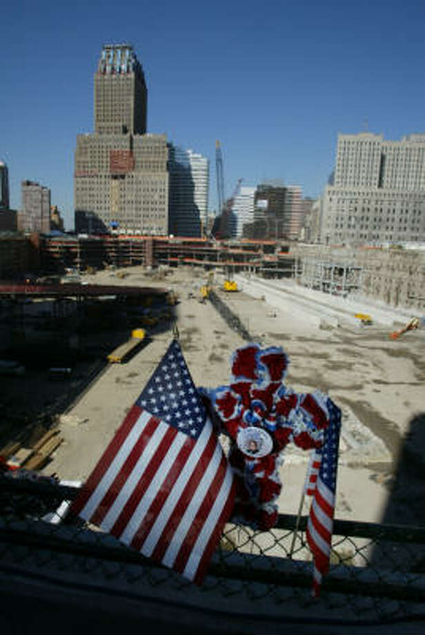U.S. flags and a cross honor a 9/11 victim at the World Trade Center site a year after the horrific attacks in 2001. The terrorism that hit home altered the lives of Americans. Photo: Chronicle File