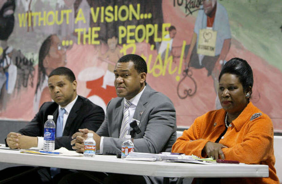 Candidates for the 18th Congressional District Sean Roberts, left, Jarvis Johnson, and Rep. Shelia Jackson Lee stated their cases during a Saturday debate in Midtown. Photo: Melissa Phillip, Chronicle