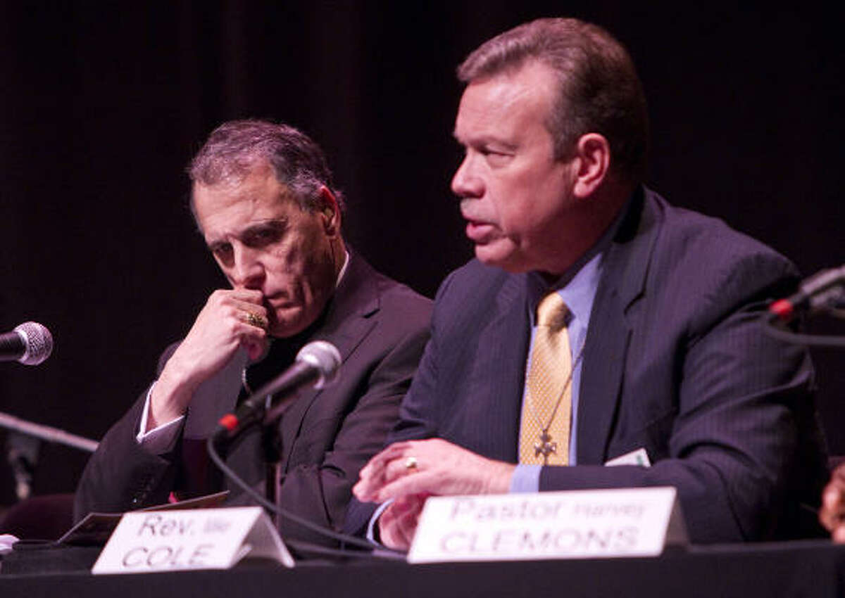 Cardinal Daniel DiNardo, left, and the Rev. Mike Cole, General Presbyter of the New Covenant Presbytery, were among the speakers calling for Texas to abolish the death penalty.
