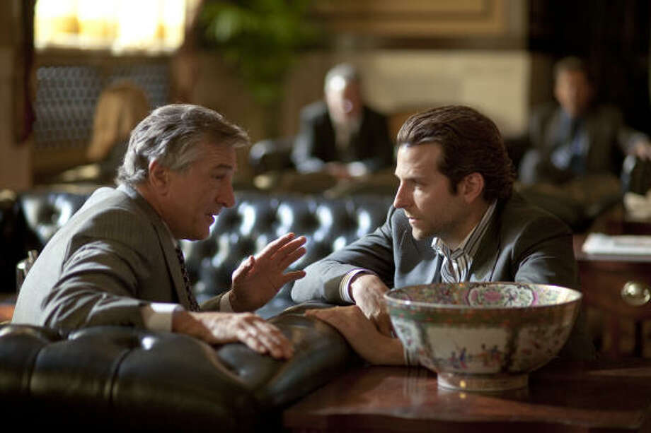 Carl (Robert De Niro, left) tells Eddie (Bradley Cooper) about the side effects of the wonder drug NZT. Photo: Dark Fields Productions