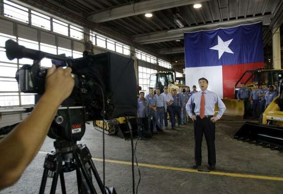 Gov. Rick Perry's highly touted live Internet appearance originated from a Caterpillar facility in San Antonio. Photo: Eric Gay, Associated Press