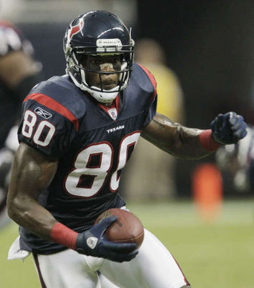Andre Johnson and the Texans will have to overcome all the early season love and refocus to beat the Redskins on Sunday, columnist Jerome Solomon writes. Photo: Julio Cortez, Chronicle