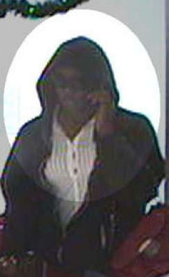 Authorities said this person, dressed as a woman, robbed a bank Wednesday afternoon in Wharton. Photo: FBI