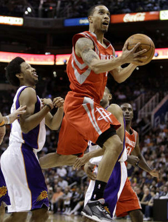 Rockets guard Courtney Lee drives past Suns forward Josh Childress, left. Photo: Matt York, AP