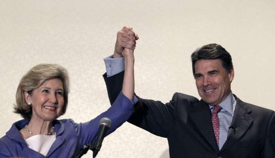 Sen. Kay Bailey Hutchison and Gov. Rick Perry put their past rivalry aside at a GOP women's breakfast on Friday. Photo: LM Otero, AP