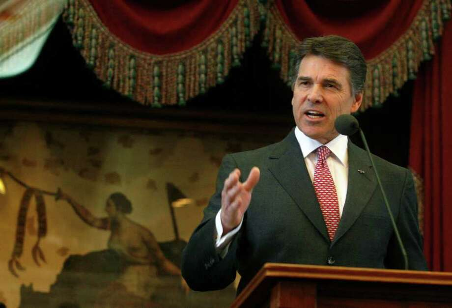 Although the day of prayer was his idea, Gov. Rick Perry, shown here in February, said he still doesn't know what role he will play in the Aug. 6 event. Jack Plunkett/The Associated Press / FR59553 AP