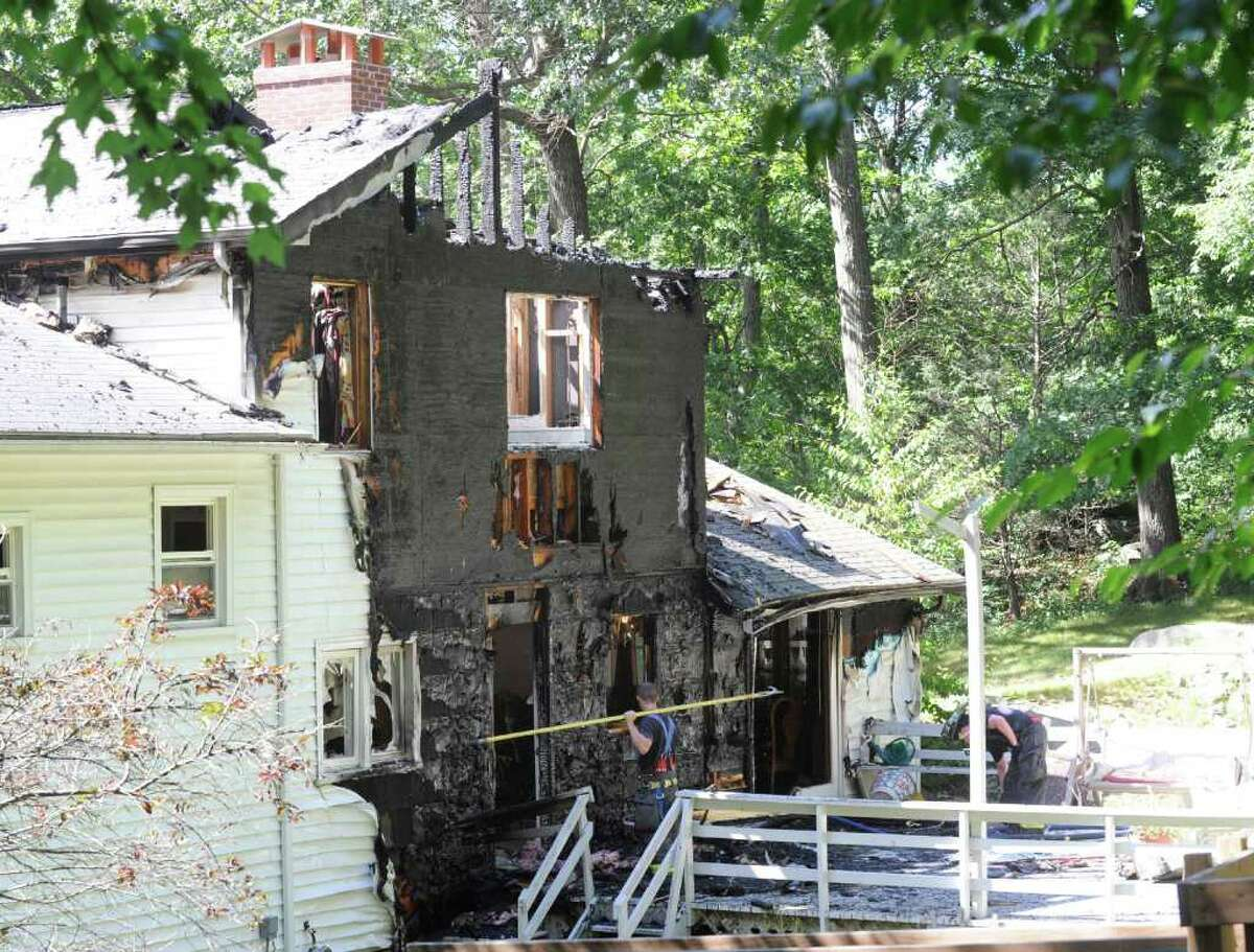 The aftermath of a house fire at 27 Deep Gorge Road in Western Greenwich Wednesday afternoon July 27, 2011. Pictured is the back area of the house where fire officials said the fire started.