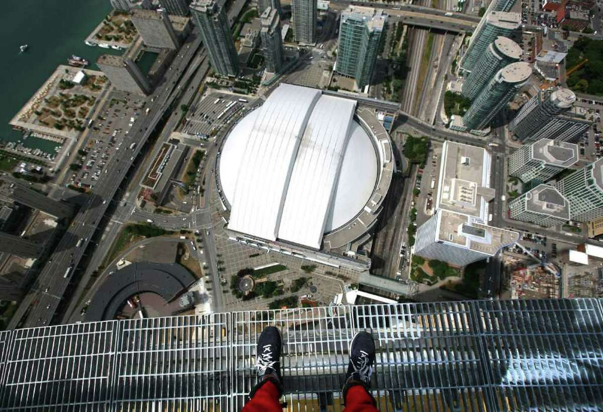 The Rogers Centre is seen from 1,168 feet over Toronto's downtown during a media preview of the EdgeWalk on Wednesday, July 27, 2011.