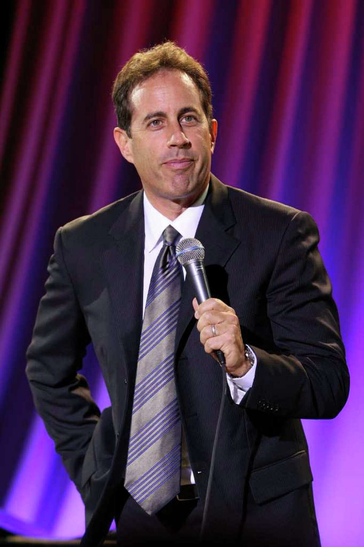 Comedian Jerry Seinfeld is in a budding alliance with Honda Motor Co. See other celebrities who've back cars.(Photo by Bryan Bedder/Getty Images)