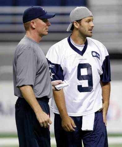 CORRECTS DATE -  Dallas Cowboys coach Jason Garrett, left, talks with quarterback Tony Romo (9) during a morning walk through  at NFL football training camp, Thursday, July 28, 2011 in San Antonio. Photo: AP