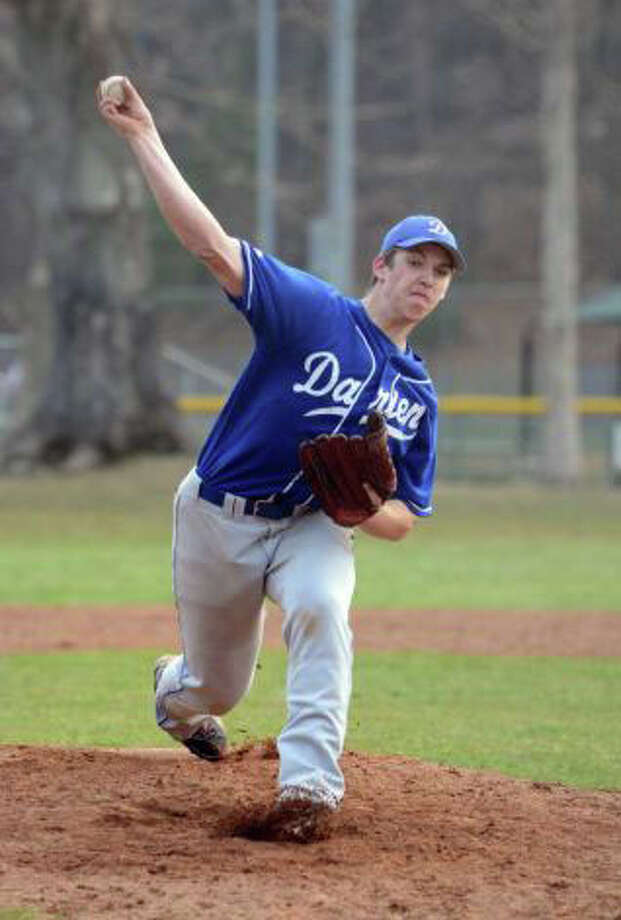 Darien's Andrew Hurn delivers a pitch during his team's 2-1 win over New Canaan on April 11 at Mead Park by Amy Mortensen Photo: Contributed Photo