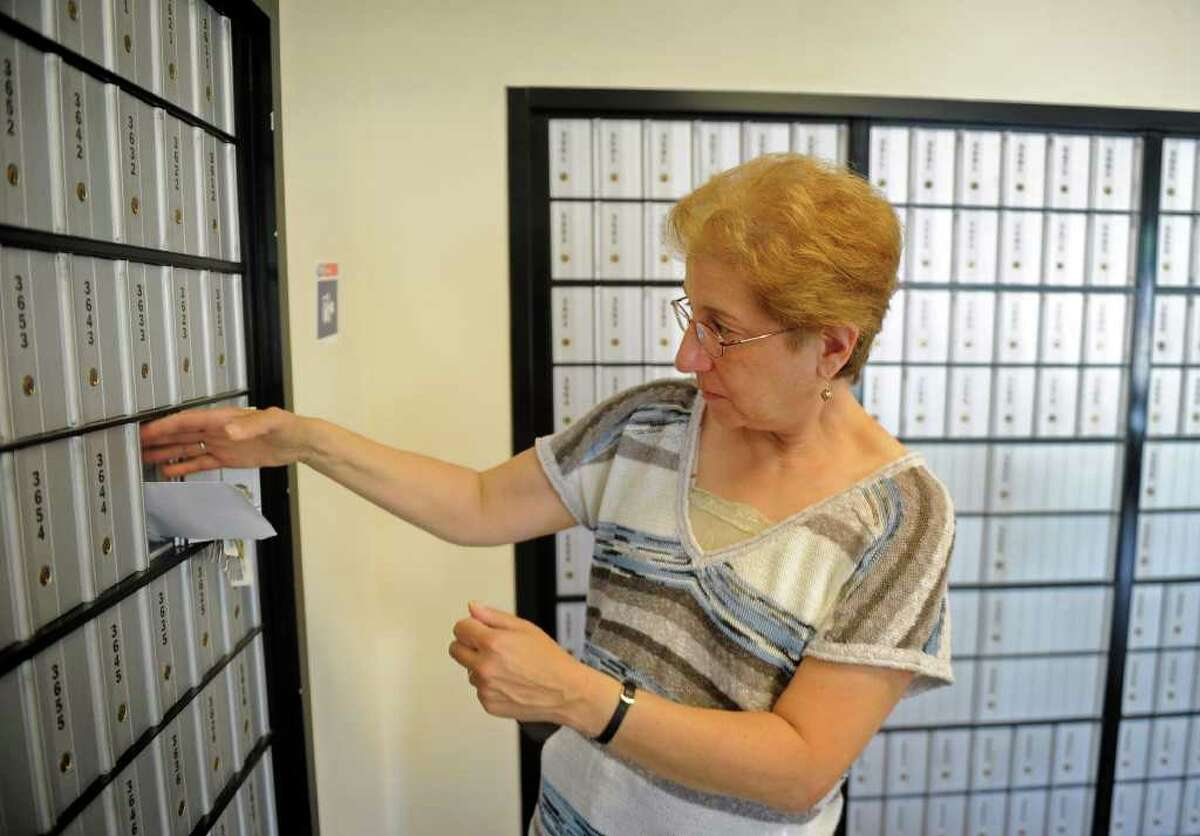 Sara Laden picks up her mail from the Barnum post office, on Fairfield Avenue in Bridgeport, Thursday, July 28, 2011. The Barnum station is one of two Bridgeport post offices recently targeted for possible closure.