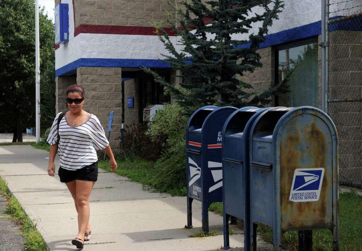 Jana Soares leaves the Barnum post office, on Fairfield Avenue in Bridgeport, Thursday, July 28, 2011. The Barnum station is one of two Bridgeport post offices recently targeted for possible closure. Soares lives nearby and recently rented a post office box for the year.