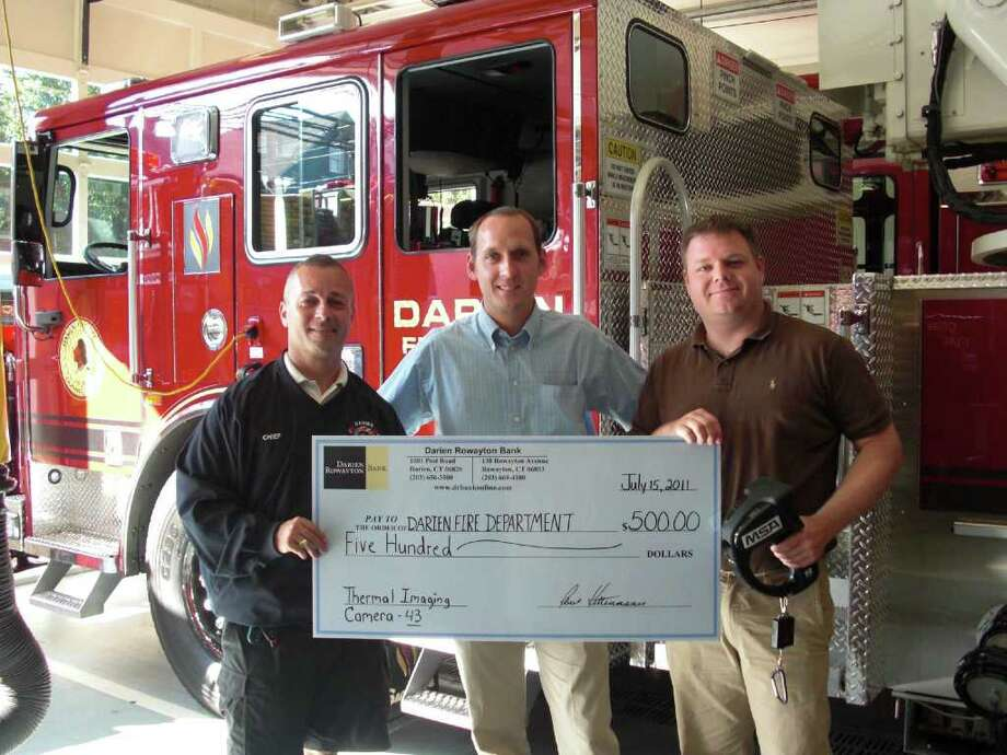 From left, Chief Richard Weatherstone, Darien Fire Department; Jack Dowling, VP/commercial lender at Darien Rowayton Bank and active member of the Darien Fire Department; and Andrew Malewicz,  lieutenant and officer of Ladder Truck 43. Photo: Contributed Photo