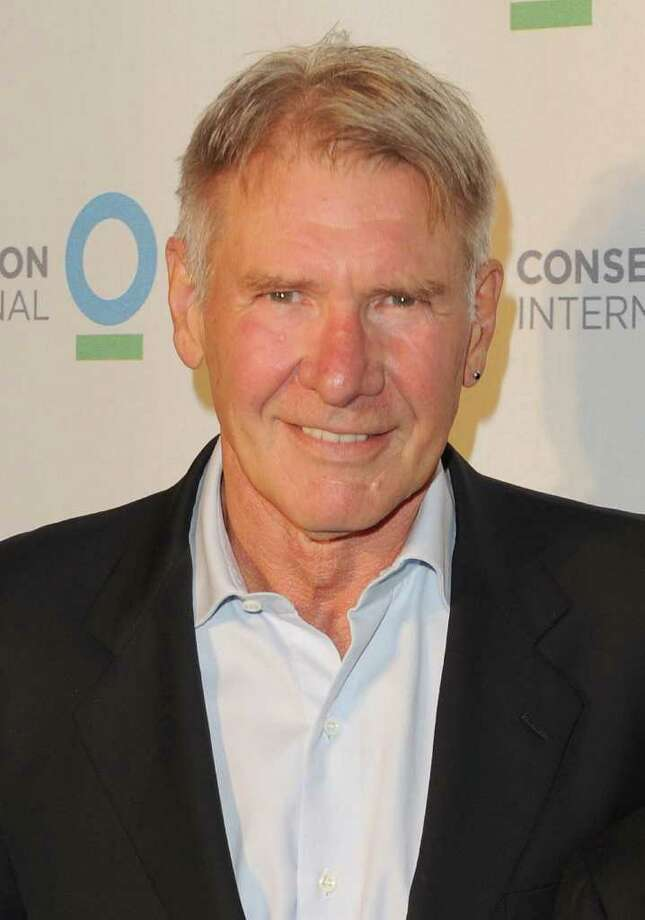 Harrison Ford isn't just Indiana Jones, he's a real-life helicopter pilot with a penchant for saving lives. In 2000, he saved a female hiker who had fallen ill with altitude sickness, stranded atop Idaho's Table Mountain. Then, in 2001, he came to the rescue of a Boy Scout who was lost overnight in Yellowstone National Park. Photo: Jason Merritt, Getty Images / 2011 Getty Images